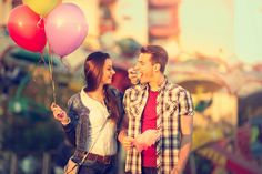 Love couple in amusement park with cotton candy stock photo