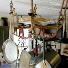 A beautiful antique sled is given new life as a hanging pot rack in an old farmhouse
