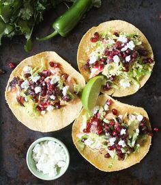 Grilled salmon tacos topped with pomegranate and jalapeño salsa knock tacos from a box out of the water.