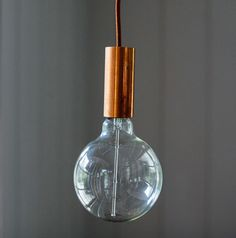 Copper Bulb Pendant Light: A striking copper pipe pendant that catches the light beautifully, creating a warm glow of copper. This bulb pendant comes with a copper casing to the E27 bulb holder and an adjustable 3m copper coloured textile cable. Our Mega Globe 40w incandescent filament bulb is included to finish the look.