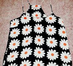 "<p dir=""ltr"">LUVALOT Floral Women's Girls Top . Condition is Pre-Owned but perfect. </p> <p dir=""ltr"">Sent with Australia Post Standard Small Box/Satchel.</p> Black Bralette, Cami Crop Top, Tank Shirt, Khaki Green, Small Boxes, Bra Tops, Clubwear, Satchel, Australia"
