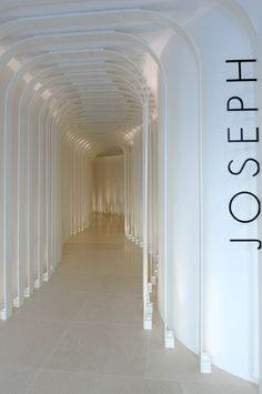 Store entrance, luxury designer fashion 'Joseph' in Paris av Montaigne, by Raed Abillima architect -Tuba TANIK Retail Boutique, Boutique Interior, Commercial Design, Commercial Interiors, Visual Merchandising, Hotel Corridor, Interior Architecture, Interior Design, Shop Fittings