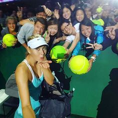 Maria Sharapova takes a selfie with her fans after her first completed match since Wimbledon!  #WTAFinals