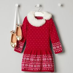 Festive sweater dress in cozy combed cotton is perfect for winter parties. Features snowflake Fair Isle print and a plush faux fur collar.