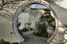 A Moon Gate (Chinese: 月门; pinyin: yuèmén) is a circular opening in a garden wall that acts as a pedestrian passageway, and a traditional architectural element in Chinese gardens. Moon Gates have many different spiritual meanings for every piece of tile on the gate and on the shape of it.