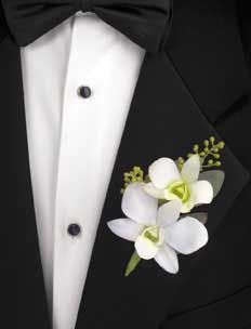 White Dendrobium Orchid Boutonniere http://www.bayfrontfloral.com/wp-content/uploads/2013/01/WHITE%20DENDROBIUM%20ORCHID.jpg Hawaii Weddings by Tori Rogers www.hawaiianweddings.net