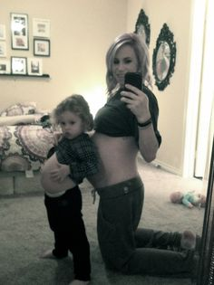 Im so getting a pic of me and Paige like this since she already thinks everyone has a baby in their belly now
