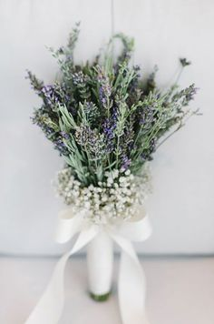 A natural bouquet features fresh rosemary, baby's breath, and gypsophila.