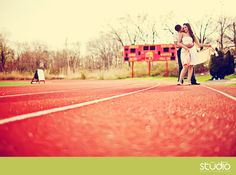 track field engagement photos by New Jersey wedding photographers www.1314studio.com