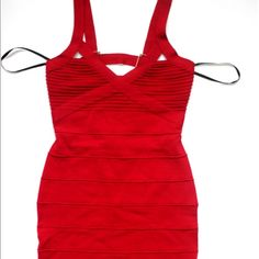 Bebe Red Bandage dress with gold back detail Damaged as pictured. Very tiny hole that can be seen together. Work once. Price marked because of the flaw. bebe Dresses Mini