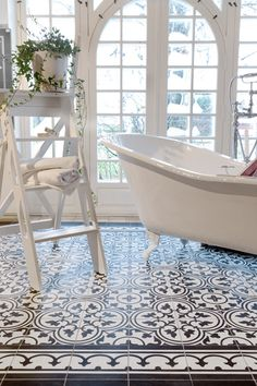 Bathroom, classic way with cement tiles. Need to add some of these to the bathroom somewhere