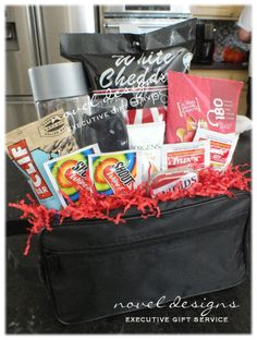 Custom Travel Relief Gift Basket w/Snacks, Water, Pain Reliever, Stain Remover, Sunglasses & More - Packaged in a travel toiletry bag.