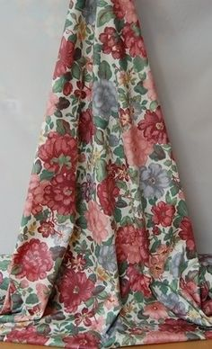 'Summertime' by Select Textiles curtain fabric, 1 of 3 colourways...reds with pinks and pale blue. This busy floral in 100% cotton would make lovely scatter cushions and bedding.