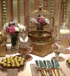 Our vintage lolly / candy buffet in pink, gold and champagne with vintage crystal vases, flowers and gold birdcage.