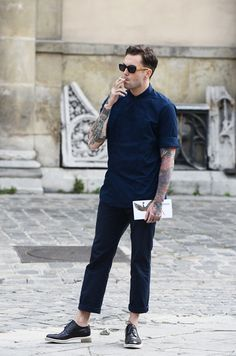 Shop this look for $96:  http://lookastic.com/men/looks/navy-longsleeve-shirt-and-navy-chinos-and-black-leather-derby-shoes/413  — Navy Longsleeve Shirt  — Navy Chinos  — Black Leather Derby Shoes