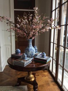 Likes: large floral arrangement in the middle, when table is not in use for studying of course. Stacks of books Small round table. EG