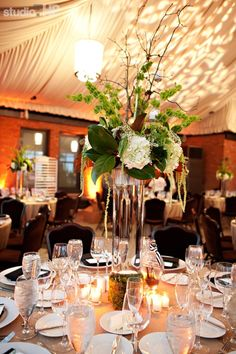 """The Citizen Hotel Sacramento, Ca Wedding """"Bendel Botanical"""" Reception centerpieces consisting of mossy branches, hydrangea, and magnolia leaves."""