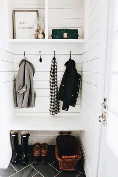 Looking for a tiny mudroom idea?   This adorable nook makes the best mudroom space. Simple enough for a DIYer to complete in a couple weekends, this mudroom nook has a bench, coat hooks, and open storage above. Oh, and shiplap walls with herringbone tile