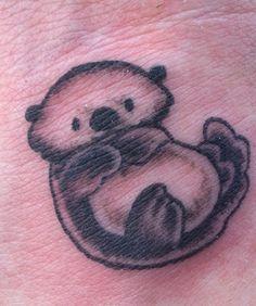 Sea otter tattoo of mine. :) he is cute.