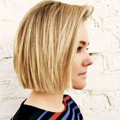 classic, blunt bob with invisible layers to remove any bulk from the hair. This allows the look to appear sharp while still laying flat.