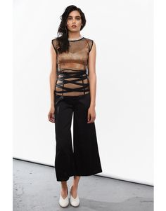 Flared cut trousers with soft bondage detailing over the corsetry inspired twofolded transparent mesh. Tied Up, Bra Tops, Capri Pants, Trousers, Feminine, Spring Summer, Cage, Collection, Fashion