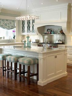 Lovely...great colors. Perfect entertaining kitchen.