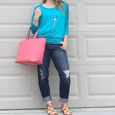 Turquoise Dolman Top 3/4 sleeve blouse. Made of 95% rayon/5% spandex. Tops