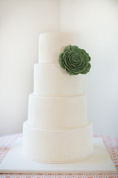 simple white wedding cake - photo by Amy and Jordan Photography http://ruffledblog.com/a-desert-chic-wedding-with-turquoise