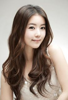 Linen color with a body length curly hair
