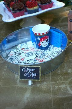 Tattoo parlor from A Pirates Life Outdoor Pool Party at Kara's Party Ideas. See more at karaspartyideas.com!