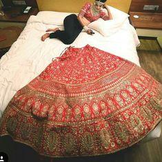 look at this lazy bride. Indian Bridal Outfits, Indian Bridal Lehenga, Indian Bridal Fashion, Bridal Dresses, Indian Dresses, Wedding Lehnga, Sabyasachi Bride, Lengha Saree, Bollywood Lehenga