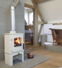 This is a good white stove/pale hearth/wood floor combo Wood Fuel, Multi Fuel Stove, Traditional Fireplace, Wood Burner, Grey Flooring, White Wood, Bathroom Inspiration, Hearth, Modern