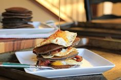 Gluten Free Buckwheat Pancakes stacked with eggs and bacon | http://www.theroastedroot.net #glutenfree