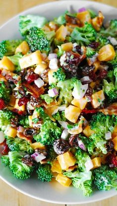 Broccoli salad with bacon, raisins, and cheddar cheese ~ The perfect summer party and picnic salad everyone will love! | gluten free recipe