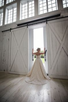 This is one of my favorite shots during this bridal shoot at The White Sparrow Barn #doors #bride #weddingdress