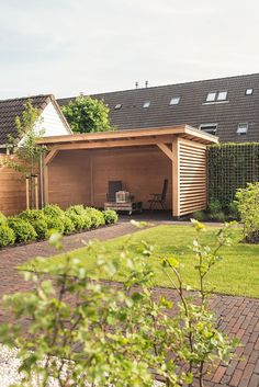 Veranda met tuinaanleg in #veenendaal. #totaalconcept Buitenpracht Hoveniers & Buitenpracht Stijlvolle Houtbouw
