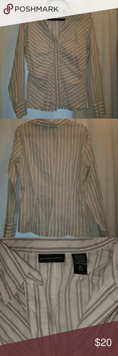 Striped collared blouse Grey striped collared blouse with small metallic silver threading. Ruched stretch front. Great for those who suffer from buttons gapping on button downs. Looks new- only worn once or twice. New York & Company Tops Blouses