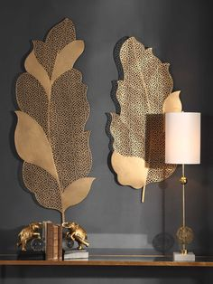 Intricate lace-like detail is cut into the Uttermost Autumn Lace Leaf Wall Art - Set of 2 's metal design. The whimsical feather shapes bring soft. Gold Wall Art, Metal Wall Art Decor, Wall Decor Set, Mural Wall Art, Wall Art Sets, Framed Wall Art, Wall Décor, Metal Leaf Wall Art, Wall Decorations