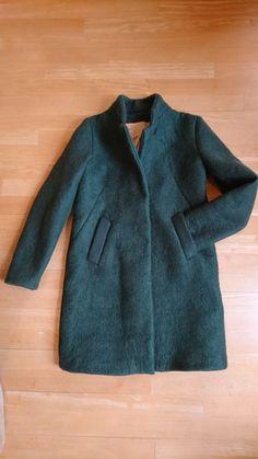 Wol Vilten en daar een jas van naaien