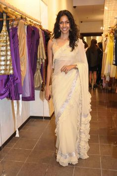 The Stylish And Elegant Ruffle Saree In Cream Colour Looks Stunning And Gorgeous With Trendy And Fashionable Georgette Fabric Looks Extremely Attractive And Can Add Charm To Any Occasion. Fancy Sarees, Party Wear Sarees, Indian Dresses, Indian Outfits, Indian Clothes, Saree Wearing, Drape Sarees, Sari Design, Modern Saree