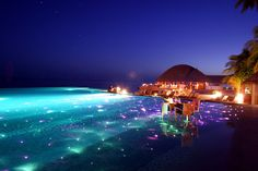 With twinkling fairy lights glowing under the water, at night the infinity pool at Huvafen Fushi Resort in the Maldives becomes an other-worldly reverse image of the night sky. Description from infinityswimmingpools.co.uk. I searched for this on bing.com/images