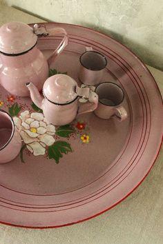 Pink enamelware toy tea set