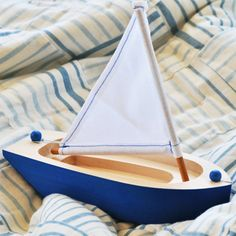 Wooden sailboat. Made with non toxic paint, this boat makes into nightly baths and has made a numerous voyages on the backyard pond.