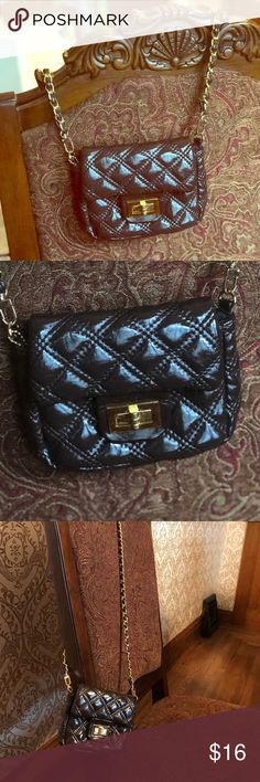 """Small Purse Chain-Link Handle This purse is a dark burgundy color. Very long chain- 49"""" in total. Purse itself is small, 7"""" across front, 5"""" tall. Has one small coin zipper pocket inside. Great condition! No visible wear. Big Buddha Bags Mini Bags"""