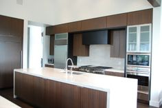 I love the Clean, Modern Look of this Kitchen. Beautiful Mahogany Cabinetry with an accent stain color. It's very rewarding to help my clients with their Kitchen Design.