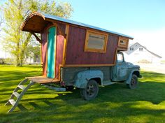 A hand-built camper mounted to a 1960 4×4 Dodge Power Wagon.