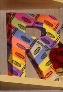 Crayon wrappers Mod-Podged onto paper-maché letter form