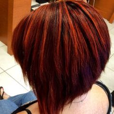 Edgy red angle bob by stylist Danielle at our Hair Cuttery-Groton Shoppers Mart salon.