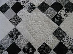 This is a fairly new quilter who wanted to make a big quilt for her son and DIL. She made up the pattern, so the squares weren't a normal size. To get the...