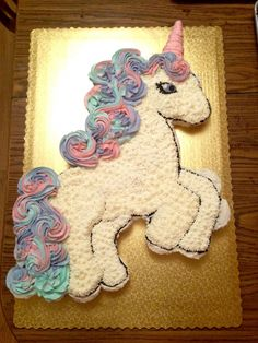 Unicorn cupcake cake! Used about 40 cupcakes in both vanilla and chocolate. #unicorncake